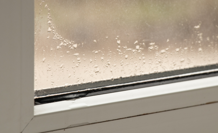 Excess moisture causes liquid to accumulate on a window.