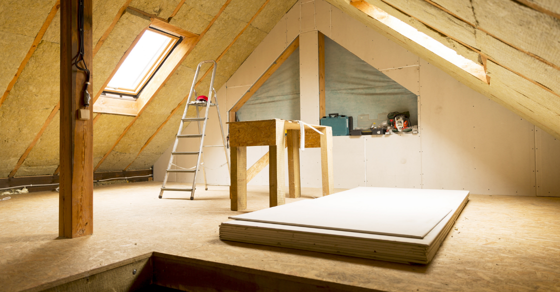 house attic under construction mansard wall insulation with rock wool.